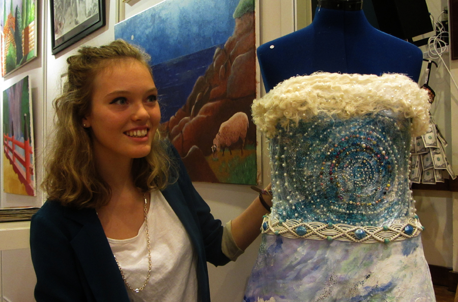 Megan Hart with ball dress she designed and made.